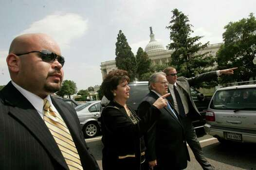 Surrounded by his security team from Cornerstone Church including, Chris Flores, left, and Philip Fortenberry, right, San Antonio Pastor John Hagee and his wife, Diana Hagee, make their way to a meeting with Christians United for Israel's Texas delegates at the United States Capitol after a photo opportunity for the media during the Christians United for Israel's Washington Israel Summit in Washington, DC on Tuesday, July 17, 2007. Photo: LISA KRANTZ, SAN ANTONIO EXPRESS-NEWS / SAN ANTONIO EXPRESS-NEWS