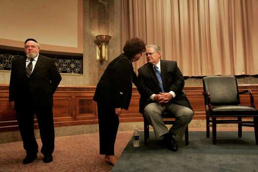Diana Hagee talks to her husband, San Antonio Pastor John Hagee, right, as he waits with San Antonio Rabbi Aryeh Scheinberg, left, of Rodfei Shalom Synagogue,  for Texas Senators John Cornyn and Kay Bailey Hutchison to arrive for a private meeting with the Christians United for Israel Texas delegates in the Dirksin Building at the United States Capitol on Wednesday, July 18, 2007.  Photo: LISA KRANTZ, SAN ANTONIO EXPRESS-NEWS / SAN ANTONIO EXPRESS-NEWS
