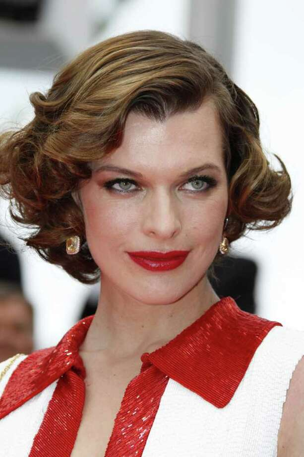 "Actress Milla Jovovich poses on the red carpet before the screening of ""La Conquete"" (The Conquest) presented out of competition at the 64th Cannes Film Festival in Cannes. Photo: AFP/Getty Images"