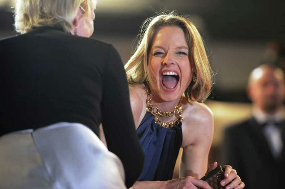"US actress Jodie Foster laughs on the red carpet before the screening of ""Melancholia"" presented in competition at the 64th Cannes Film Festival in Cannes. Photo: AFP/Getty Images"
