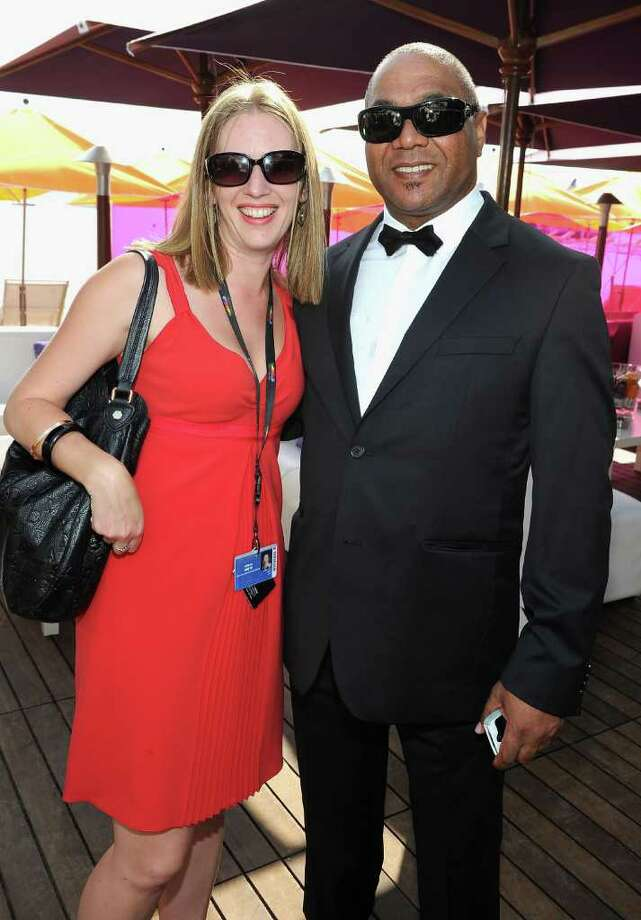 Alison Smith of the Hollywood Reporter and Eddie Mbalo attend a Hollywood Reporter party honoring Jodie Foster presented by vitaminwater during the 64th Annual Cannes Film Festival at Majestic Beach Pier in Cannes, France. Photo: Michael Buckner, Getty Images / 2011 Getty Images