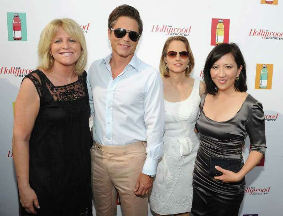 (L-R) Hollywood Reporter Publisher Lori Burgess, actor Rob Lowe, actress Jodie Foster and writer Janice Min attend a Hollywood Reporter party honoring Jodie Foster presented by vitaminwater during the 64th Annual Cannes Film Festival at Majestic Beach Pier in Cannes, France. Photo: Michael Buckner, Getty Images / 2011 Getty Images
