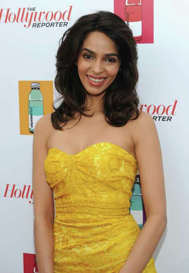 Actress Mallika Sherawat attends a Hollywood Reporter party honoring Jodie Foster presented by vitaminwater during the 64th Annual Cannes Film Festival at Majestic Beach Pier in Cannes, France. Photo: Michael Buckner, Getty Images / 2011 Getty Images
