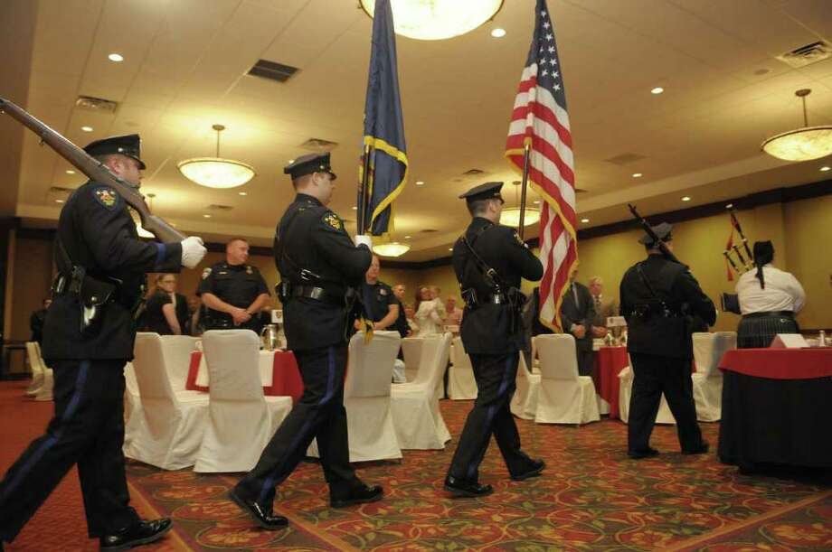 The Troy Police Department color guard marches in to post the flags during the Troy Police Department 26th Annual Awards Ceremony on Thursday morning, May 19, 2011 in Troy.    (Paul Buckowski / Times Union) Photo: Paul Buckowski  / 00013199A