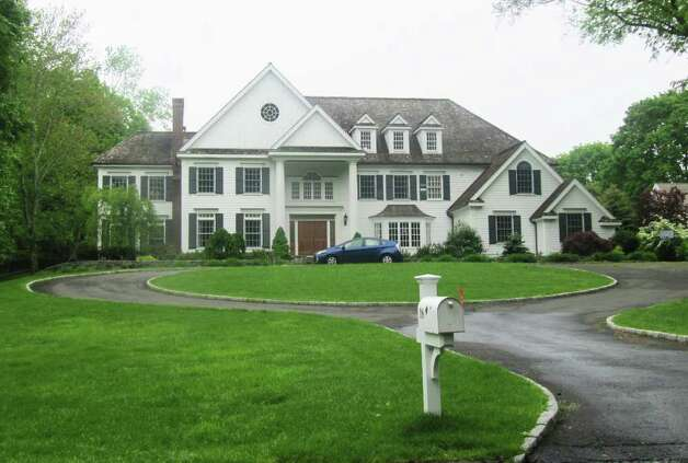 Pictured is the Woody Lane home of New York Times technology columnist and CBS News correspondent David Pogue. Pogue and his wife Jennifer were each issued a summons for disorderly conduct following a dispute Monday at their Westport residence. Photo: Kirk Lang / Westport News