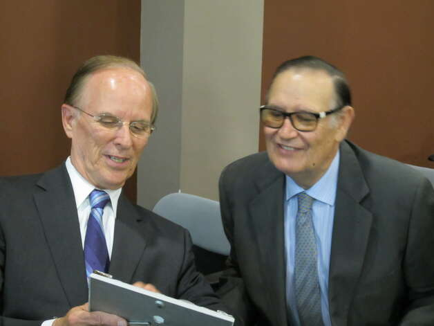Bexar County Judge Nelson Wolff, left, and Spain's Duque de Bejar, Don Pedro de Alcantara Roca de Togores y Salinas, view a framed photo together on Monday.