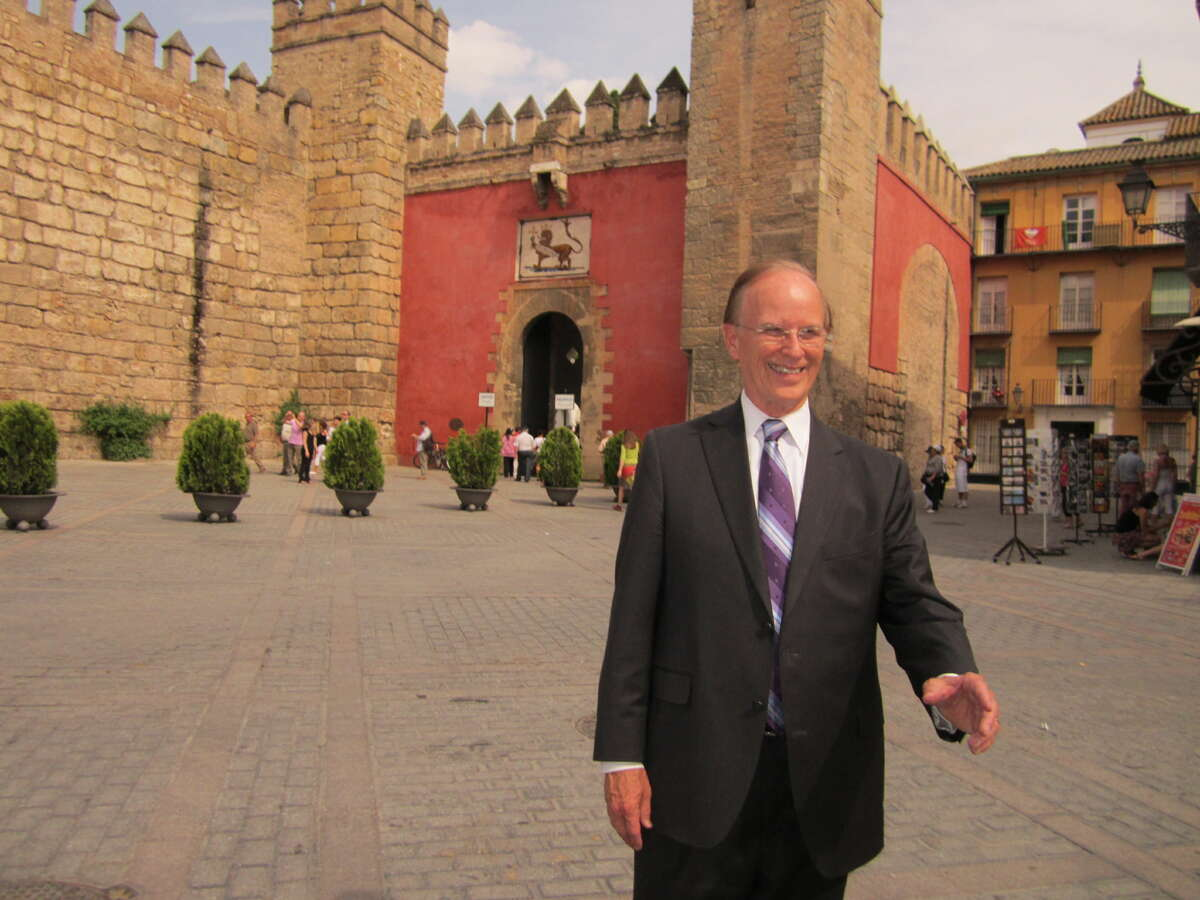 Bexar County Judge Nelson Wolff walks in front of Sevilla's Alcazar, or castle, Monday.