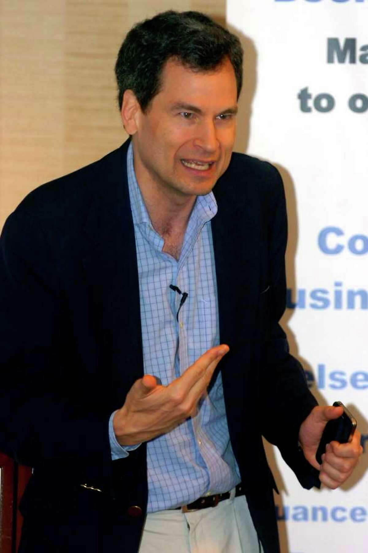David Pogue, the New York Times technology columnist and CBS News correspondent, speaks at the Technology Today Business Forum at the Courtyard by Marriott in Shelton, Conn. Thursday, May 19th 2011. Pogue and his wife have been charged with disorderly conduct following a domestic dispute Monday at their Westport home that police said turned physical.