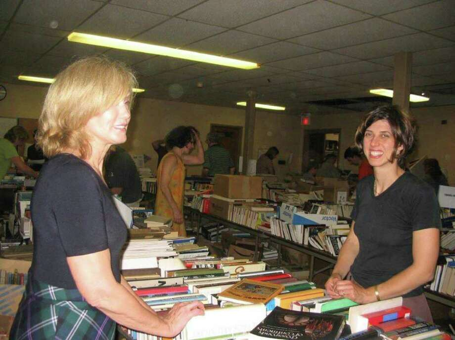 The Friends of the Byram Shubert Library will be holding its popular Book & Media Sale inside St. Paul's Lutheran Church, next to 55 William Street West, on June 10-12. The event will offer an estimated 40,000 books, CDs, DVDs, videos, and audiobooks. Above, Susanne Wahba, left, and Lisa Johnson look over some of the bargains at last year's sale. Photo: Contributed Photo / Greenwich Citizen