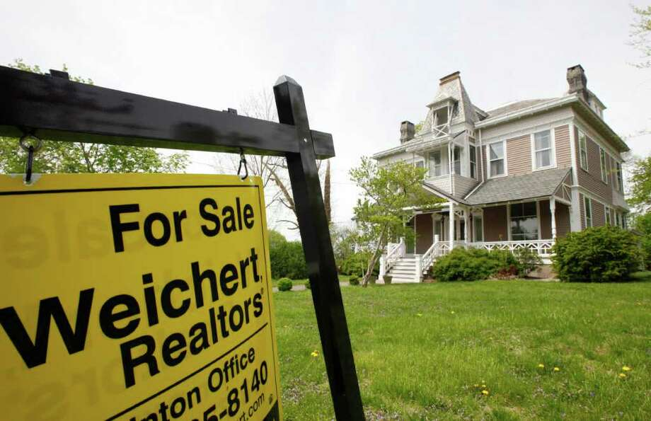 In this May 1, 2011 photo, a home in Clinton, N.J. is for sale. Existing-home sales slipped in April, although the market has managed six gains in the past nine months, according to the National Association of Realtors(R). (AP Photo/Mark Lennihan) Photo: Mark Lennihan