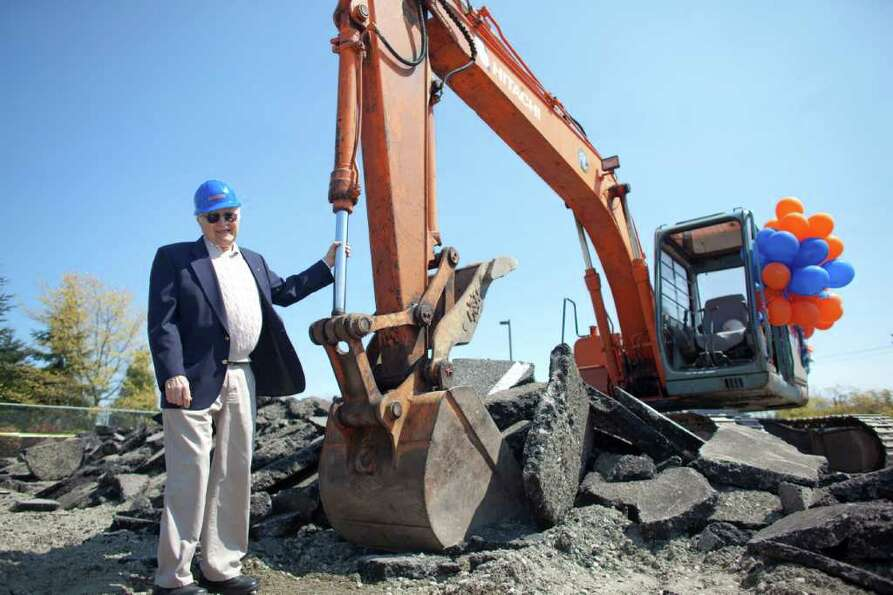 Dick Spady, namesake of Dick's Drive-In, poses with construction equipment during the groundbreaking