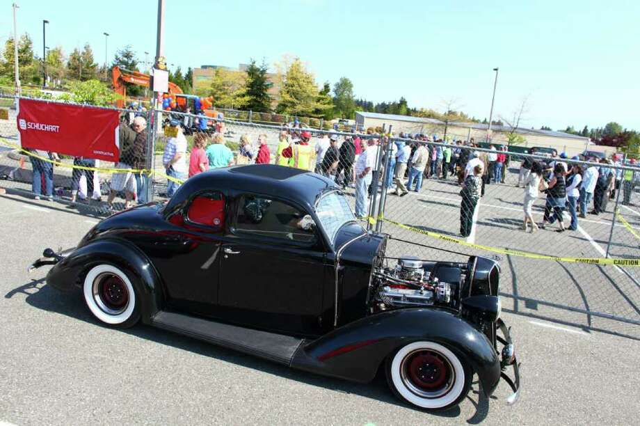 A classic car cruises past during the groundbreaking for the new Dick's Drive-In on Thursday, May 19, 2011 on Highway 99 in Edmonds. Photo: JOSHUA TRUJILLO / SEATTLEPI.COM