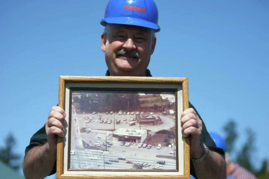 Rick Hertzog, who owned an A&W at the same location, holds a photo of his old shop during the groundbreaking for the new Dick's Drive-In on Thursday, May 19, 2011 on Highway 99 in Edmonds. The A&W was open from the 1959 thru 1993. Photo: JOSHUA TRUJILLO / SEATTLEPI.COM