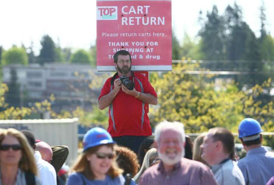 People watch the groundbreaking for the new Dick's Drive-In on Thursday, May 19, 2011 on Highway 99 in Edmonds. Photo: JOSHUA TRUJILLO / SEATTLEPI.COM