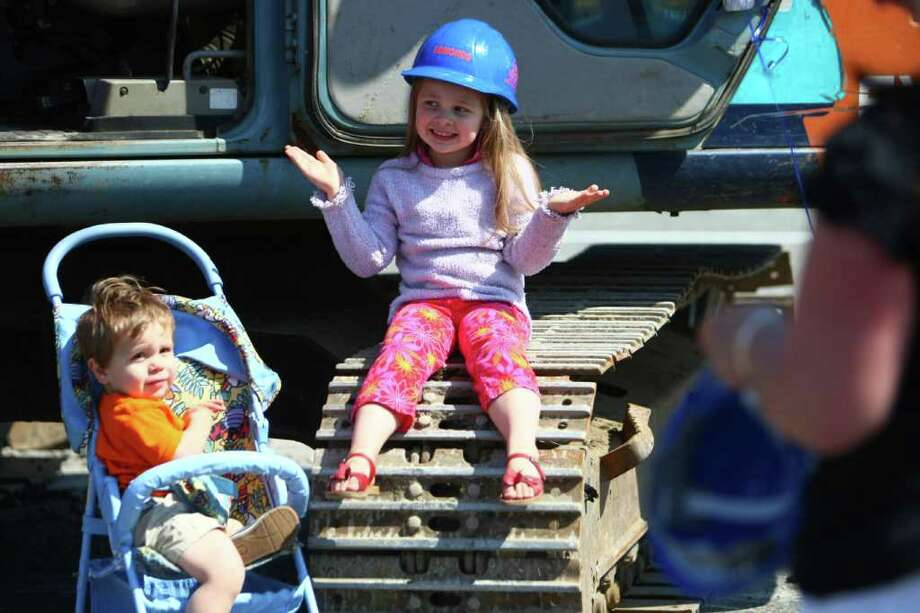 A young spectator has some fun during the groundbreaking for the new Dick's Drive-In on Thursday, May 19, 2011 on Highway 99 in Edmonds. Photo: JOSHUA TRUJILLO / SEATTLEPI.COM