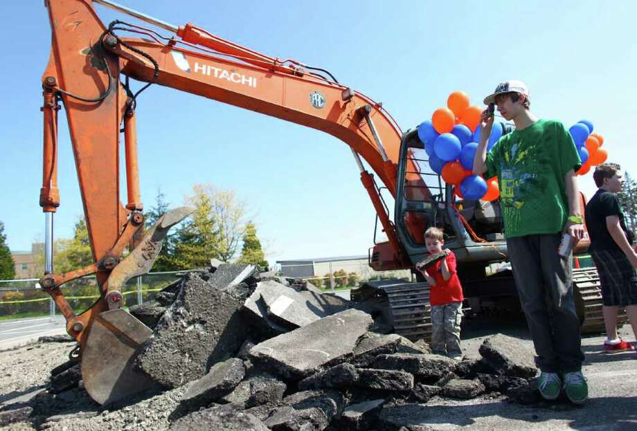 Kristian Trofimczuk, 5, left, and his brother Taylor, 14, check out the scene during the groundbreaking for the new Dick's Drive-In on Thursday, May 19, 2011 on Highway 99 in Edmonds. Photo: JOSHUA TRUJILLO / SEATTLEPI.COM