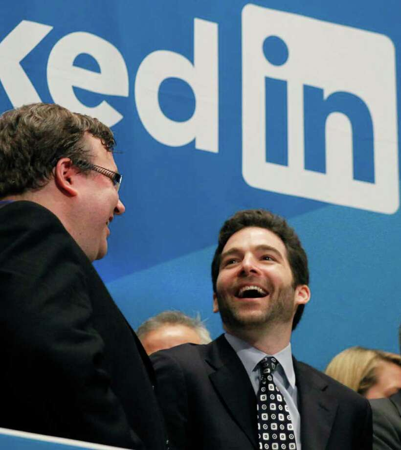 Reid Hoffman, left, the founder of LinkedIn, and Jeff Weiner, the company's CEO, celebrate the listing of LinkedIn, Thursday, May 16, 2011, on the New York Stock Exchange. LinkedIn, based in Mountain View, Calif., is an internet-based social networking rolodex for business people. (AP Photo/Mark Lennihan) Photo: Mark Lennihan