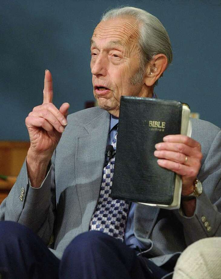 In this Dec. 12, 2002 file photo, Harold Camping speaks while holding the Bible, in San Leandro, Calif. A loosely organized Christian movement has spread the word around the globe that Jesus Christ will return to earth on Saturday, May 21, 2011, to gather the faithful into heaven. While the Christian mainstream isn't buying it, many other skeptics are believing it. The prediction originates with Camping, the 89-year-old retired civil engineer, who founded Family Radio Worldwide, an independent ministry that has broadcasted his prediction around the world. (AP Photo, File) Photo: Contributed Photo, AP File Photo / Connecticut Post Contributed; AP2002