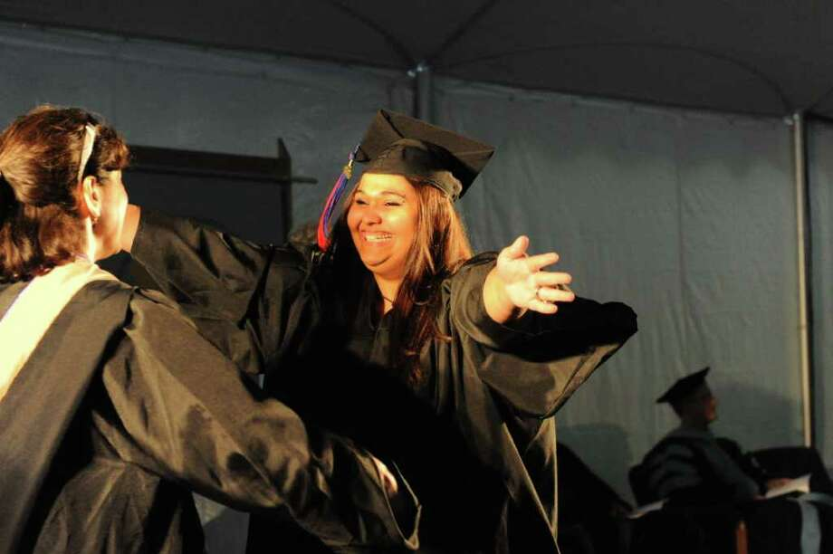 Stephanie Ewud of Redding celebrates during the 2011 commencement ceremony at Norwalk Community College in Norwalk, Conn., May 19, 2011. Photo: Keelin Daly / Stamford Advocate