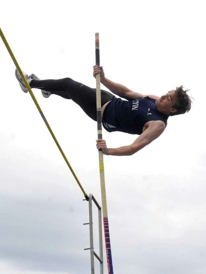 Wilton's Ned Hemmerle competes in the pole vault at Thursday's track meet at Wilton High School on May 19, 2011. Photo: Lindsay Niegelberg / Connecticut Post
