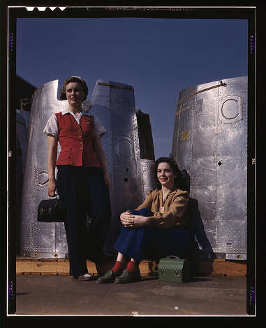 Two assembly line workers at the Long Beach, Calif., plant of Douglas Aircraft Company enjoy a well-earned lunch period, Long Beach, Calif. Nacelle parts of a heavy bomber form the background. Oct. 1942. (LOC) Photo: Library Of Congress 1940s Color Photo Collection / No known restrictions on publication