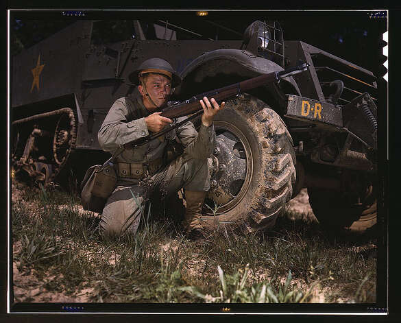 Infantryman with halftrack, a young soldier of the armed forces, holds and sights his Garand rifle like an old timer, Fort Knox, Ky. He likes the piece for its fine firing qualities and its rugged, dependable mechanism. June 1942. (LOC) Photo: Library Of Congress 1940s Color Photo Collection / No known restrictions on publication