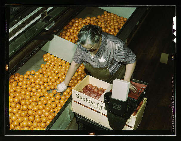 Packing oranges at a co-op orange packing plant, Redlands, Calif. Santa Fe R.R. trip. March 1943. (LOC) Photo: Library Of Congress 1940s Color Photo Collection / No known restrictions on publication