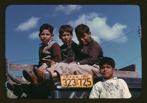 Boys sitting on truck parked at the FSA ... labor camp, Robston, Tex. Jan. 1942. (LOC) Photo: Library Of Congress 1940s Color Photo Collection / No known restrictions on publication