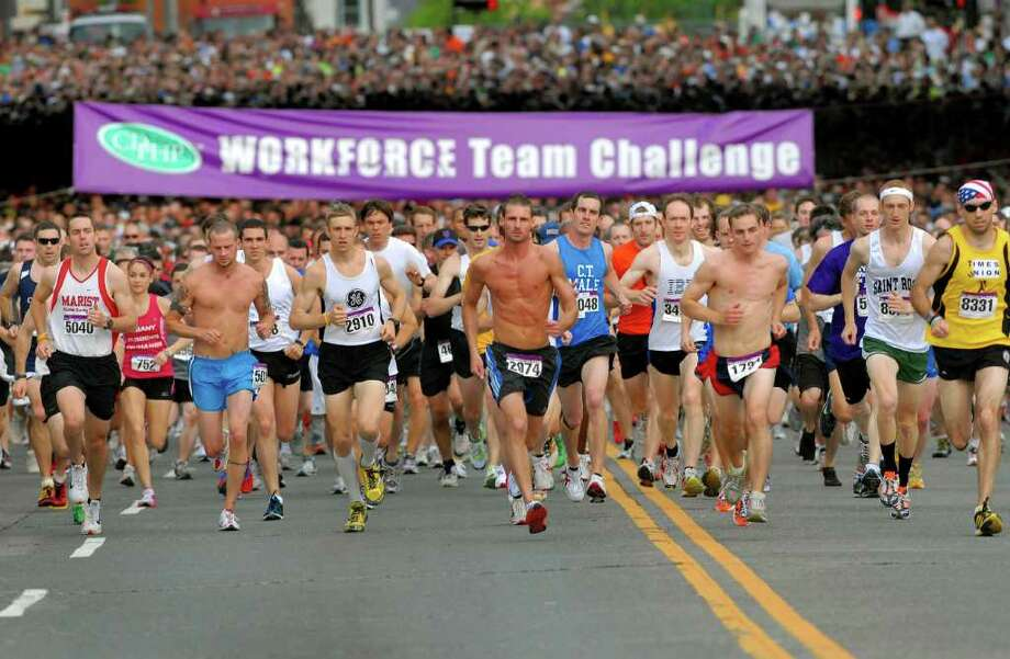 Runners run up Madison Avenue during the Workforce Team Challenge 5K run on Thursday, May 19, 2011, in Albany, N.Y. (Cindy Schultz / Times Union) Photo: Cindy Schultz / 00013205A