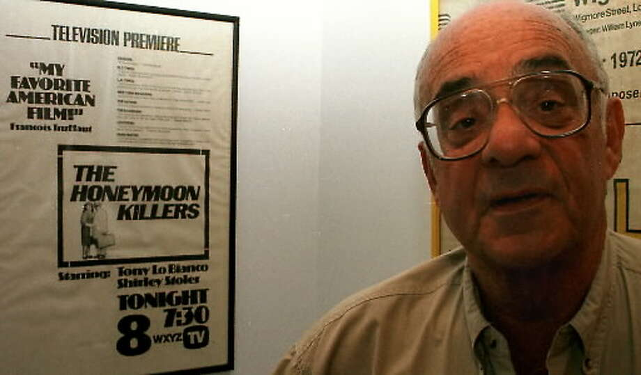 """Director Leonard Kastle stands with a poster of the movie """"The Honeymoon Killers."""" (Times Union archive)"""