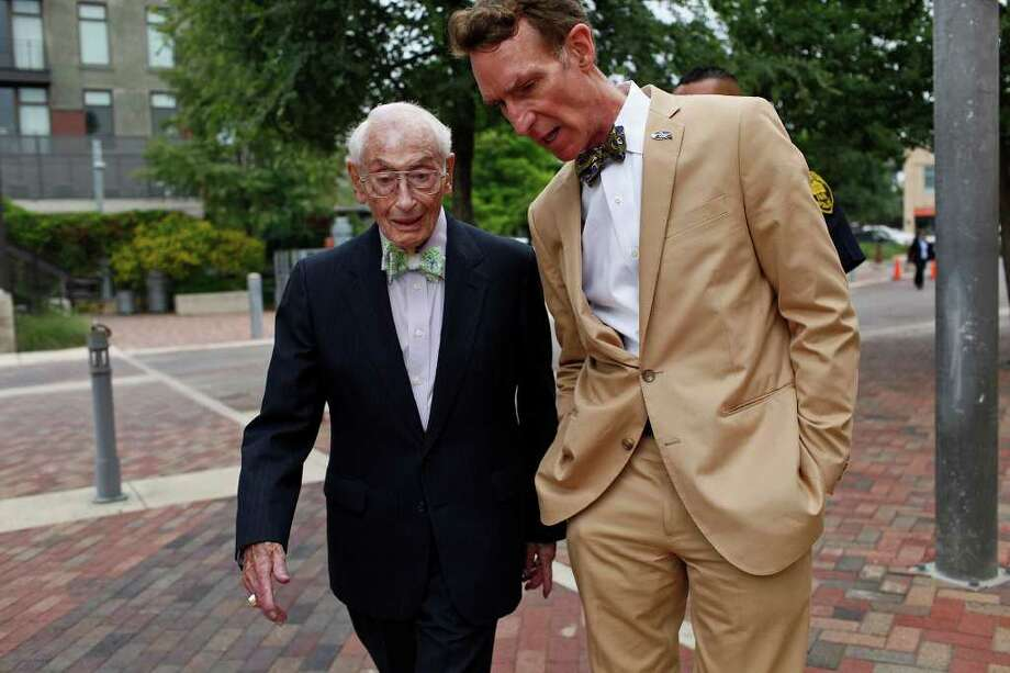Bill Sinkin, celebrating his 98th birthday, walks with Bill Nye the Science Guy, to Sinkin's party and fundraiser at the Pearl Stable in San Antonio on May 19, 2011. LISA KRANTZ/lkrantz@express-news.net Photo: LISA KRANTZ, Lisa Krantz/Express-News / SAN ANTONIO EXPRESS-NEWS