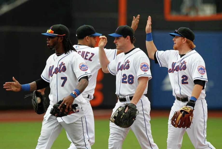 New York Mets' Justin Turner (2) celebrates with teammates Francisco Rodriguez, second from left, Daniel Murphy (28) and Jose Reyes (7) after a baseball game against the Washington Nationals, Thursday, May 19, 2011, at Citi Field in New York. The Mets won the game 1-0. (AP Photo/Frank Franklin II) Photo: Frank Franklin II
