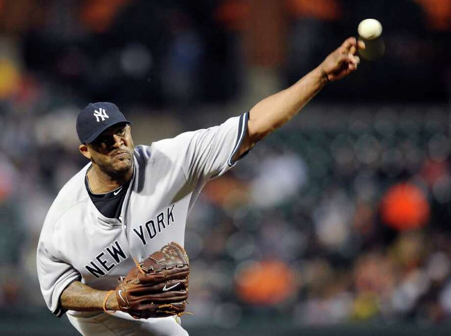 New York Yankees starter CC Sabathia delivers a pitch during the first inning of a baseball game against the Baltimore Orioles, Thursday, May 19, 2011, in Baltimore. (AP Photo/Nick Wass) Photo: Nick Wass