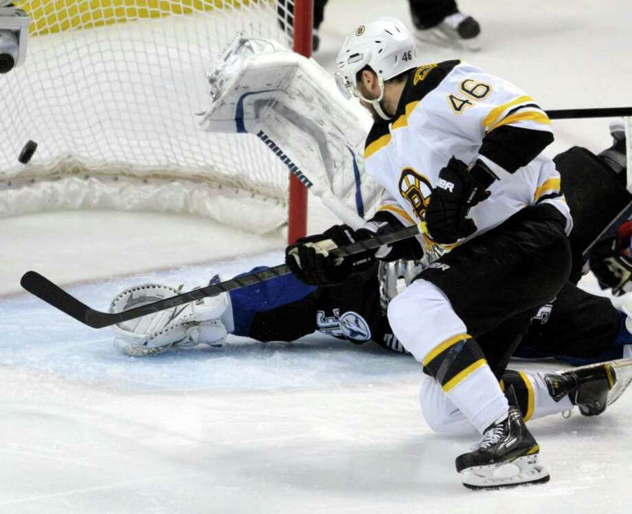 Boston Bruins center David Krejci (46), of the Czech Republic, scores against the Tampa Bay Lightning in the first period of Game 3 of the NHL hockey Stanley Cup Eastern Conference final playoff series on Thursday, May 19, 2011, in Tampa, Fla. (AP Photo/Phelan M. Ebenhack) Photo: Phelan M. Ebenhack
