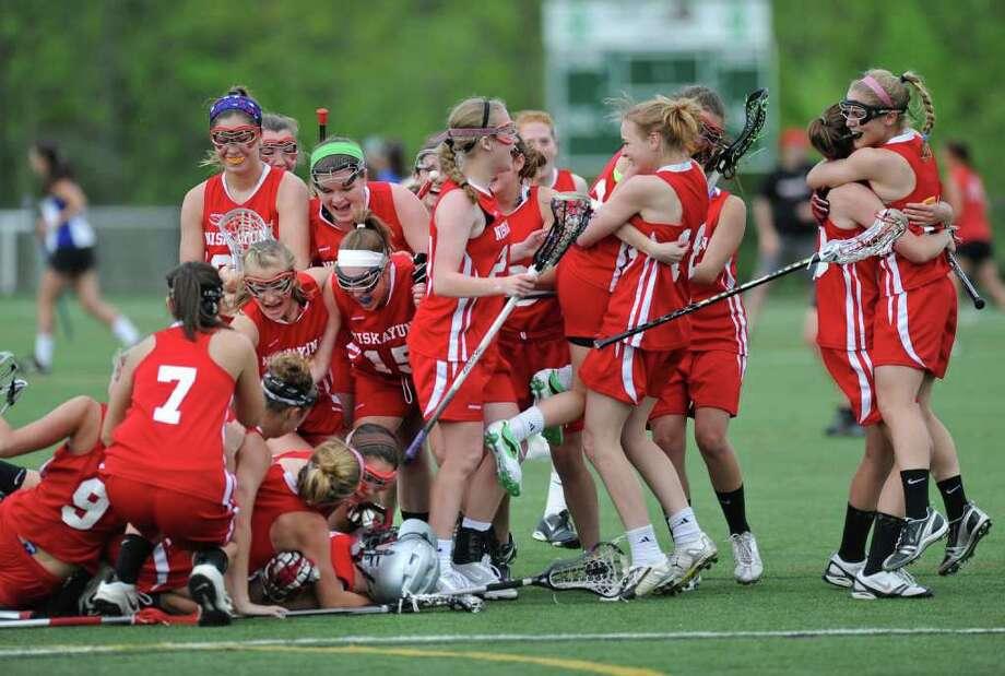 Niskayuna celebrates after winning a Class A semifinal lacrosse game against Shaker in Loudonville, N.Y. Thursday May 19, 2011. (Lori Van Buren / Times Union) Photo: Lori Van Buren