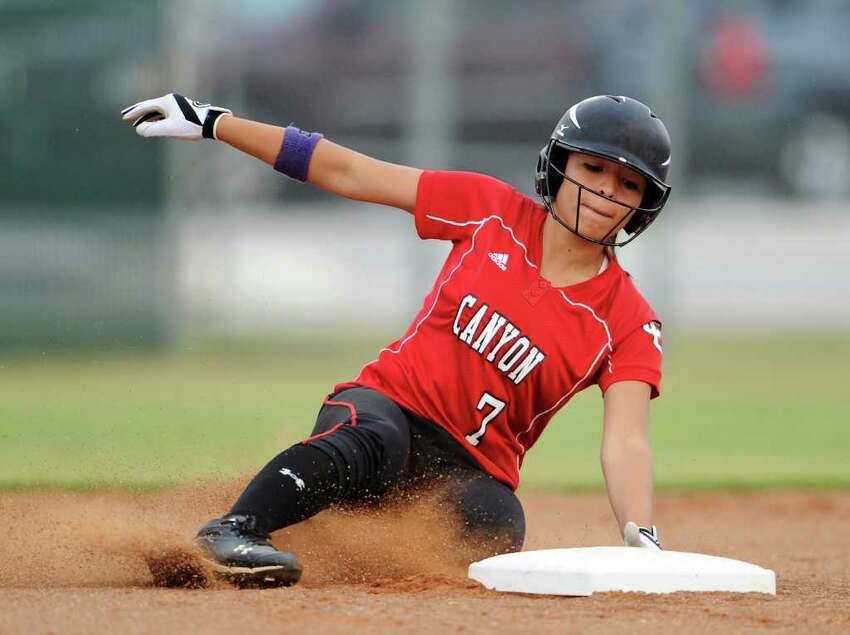 New Braunfels Canyon's Bianca Prado slides safely into second base during the Class 4A fourth-round softball playoff game between the New Braunfels Canyon Cougars and the Corpus Christi Tuloso-Midway Cherokee at the Pleasanton ISD Sports Complex in Pleasanton, Texas on May 19, 2011 John Albright / Special to the Express-News.