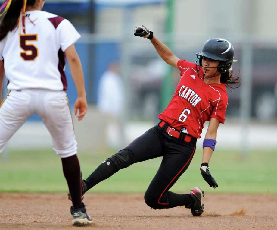 New Braunfels Canyon's Brittany Gomez (6) slides safely into second base during the Class 4A fourth-round softball playoff game between the New Braunfels Canyon Cougars and the Corpus Christi Tuloso-Midway Cherokees at the Pleasanton ISD Sports Complex in Pleasanton, Texas on May 19, 2011  John Albright / Special to the Express-News. Photo: JOHN ALBRIGHT, Express-News / San Antonio Express-News