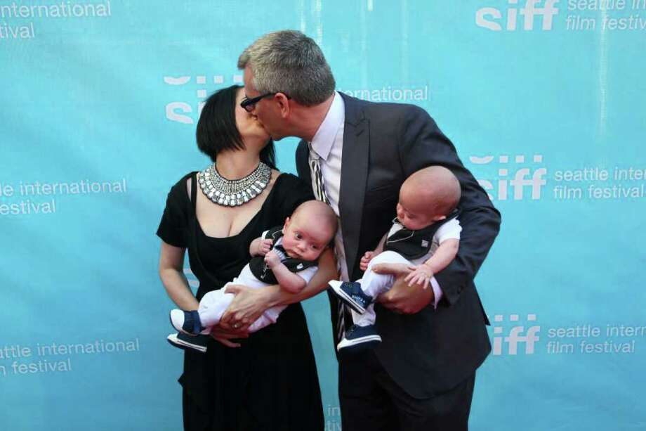 James Keblas and Heather Elsa hold their eight week-old twins Fritz and Milo on the red carpet. Keblas is director of Seattle's Office of Film + Music. Photo: JOSHUA TRUJILLO / SEATTLEPI.COM