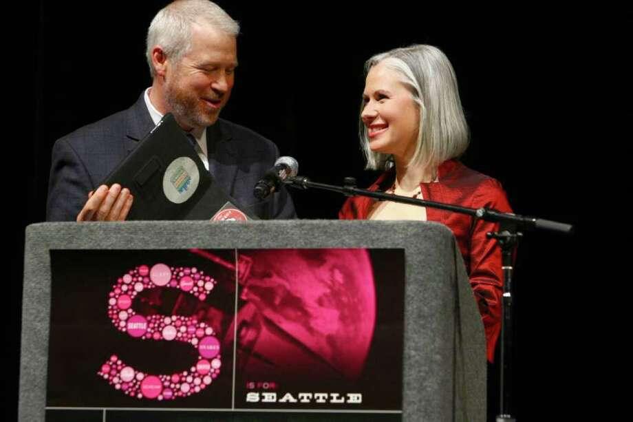 Seattle Mayor Mike McGinn give the Mayor's Award to producer Jennifer Roth. Photo: JOSHUA TRUJILLO / SEATTLEPI.COM