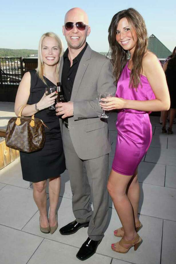 Owner of Pearl Street Pub and celebrity model Chris Pratt, center, poses with Colleen Mahoney, left, and Paige Kearbey on the patio of Taste during Rock the Runway for Health, a benefit for Whitney M. Young Jr. Health Services Programs and Services in Albany, N.Y., on May 12, 2011. (Photo by Joe Putrock / Special to the Times Union) Photo: Joe Putrock / Joe Putrock