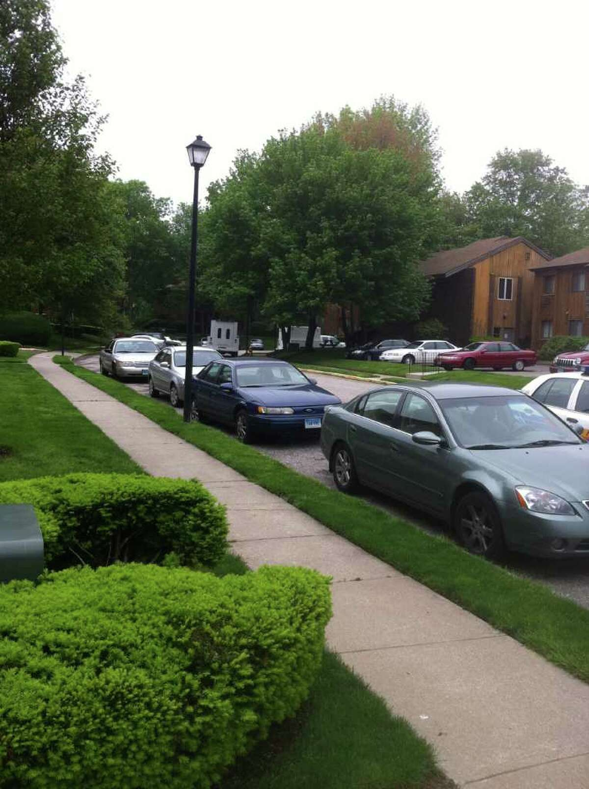 A polce car is parked near the scene of an FBI investigation on Riverview Drive in Bridgeport, Conn. on Friday, May 20, 2011. A city man was arrested Thursday after police say he sold eight home-made pipe bombs to undercover officers.