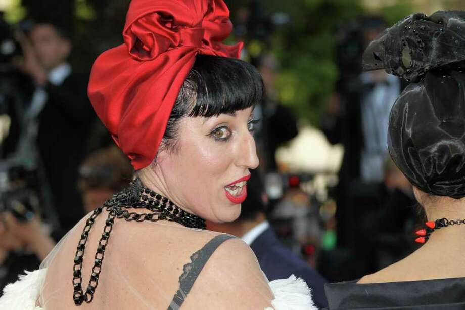 "Spanish actress Rossy de Palma poses on the red carpet before the screening of ""La Piel Que Habito"" (The Skin I Live In) presented in competition at the 64th Cannes Film Festival in Cannes.    AFP PHOTO / VALERY HACHE Photo: AFP/Getty Images"