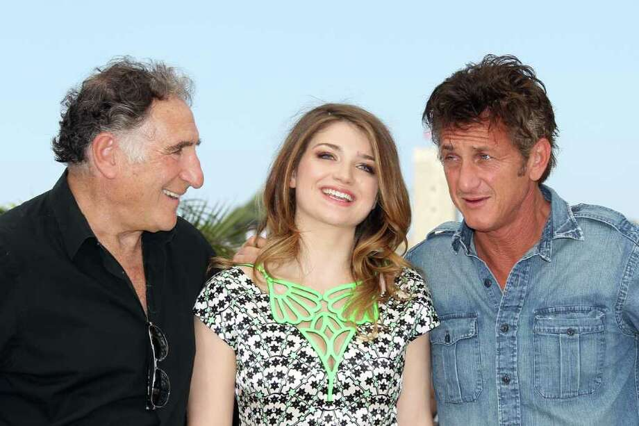 "U.S. actor Sean Penn  poses with Irish actress Eve Hewson and U.S. actor Judd Hirsch during the photocall of ""This Must Be The Place"" presented in competition at the 64th Cannes Film Festival on Friday in Cannes.     AFP PHOTO / VALERY HACHE Photo: AFP/Getty Images"