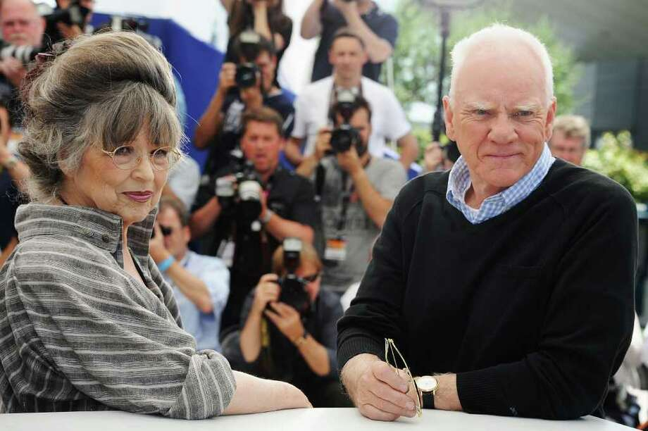 "Actor Malcolm McDowell with Stanley Kubrick's widow, Christiane Kubrick, attend the ""Le Lechon De Cinema: Malcom McDowell"" photocall during the 64th Annual Cannes Film Festival at Palais des Festivals on Friday in Cannes, France. Photo: Francois Durand, Getty Images / 2011 Getty Images"