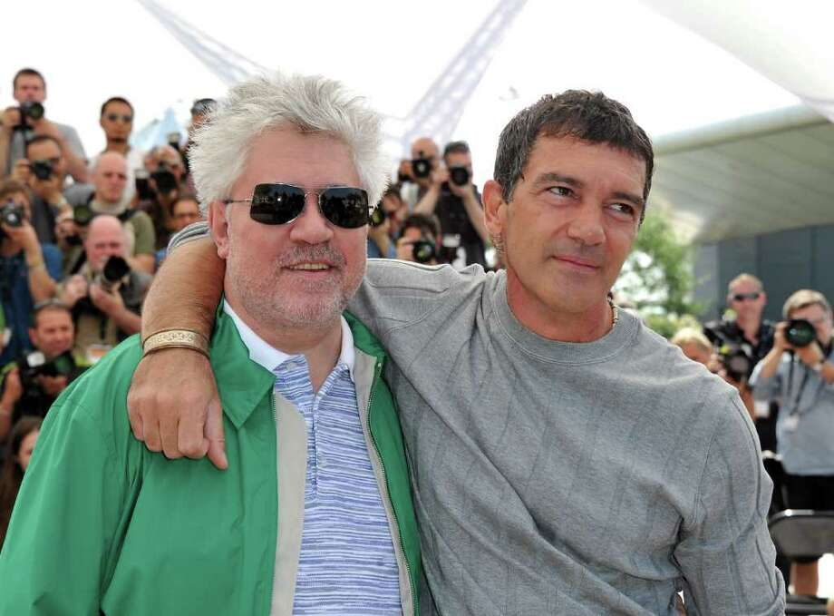 "Director Pedro Almodovar (L) and actor Antonio Banderas attend ""The Skin I Live In"" Photocall at Palais des Festivals during the 64th Cannes Film Festival in Cannes, France. Photo: Pascal Le Segretain, Getty Images / 2011 Getty Images"