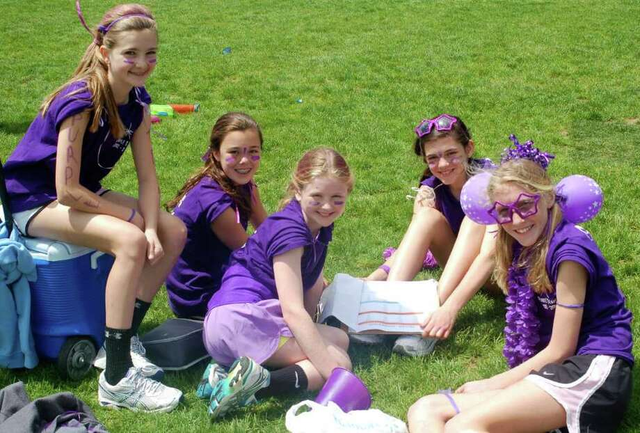 Middlesex Middle School seventh-graders enjoyed a beautiful day for their second annual seventh grade field day. The team building competition included volleyball, water balloon toss, soccer, basketball and tug of war, all in an effort to win the coveted Kobayashi Cup, named after the student who first conceived the entire event. Pictured are members if the winning Purple Team, from left, Sarah Raymond, Morgan Teinken,  Coco Steinthal, Molly Weinstock and Isabelle Taylor. Photo: Contributed Photo / Darien News