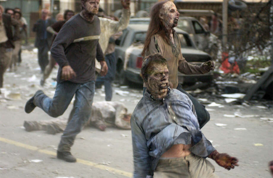 """The Zombie Apocalypse has become a particularly popular end-of-the-world scenario in recent years, spawning several popular movies and even a weekly TV series. Shown here: Zombie hordes in the 2004 remake of """"Dawn of the Dead."""" Photo: Universal Studios / Universal Studios"""