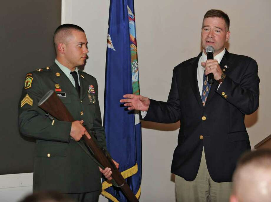 Congressman Chris Gibson  presents national Patriot Award to Dutchess County Army Sgt. Mark Hall at the New York State Military Museum and Research Center in Saratoga Springs, N.Y., on Friday May 20, 2011. (Lori Van Buren / Times Union) Photo: Lori Van Buren