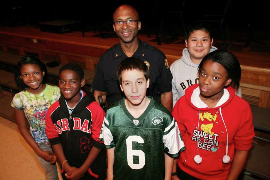 Western Middle School students, from left, Bethany Johnson, Elijah King, Jesus Salcedo, Brittany Barnes and Emilio Garcia were all awarded new bikes for excellent academic performance by Greenwich Police Officer Vincent O'Banner during a school assembly Friday afternoon. Photo: David Ames, David Ames/For Greenwich Time / Greenwich Time Freelance