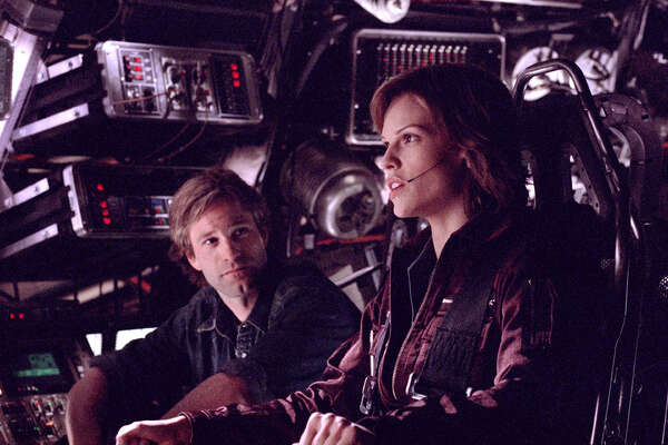 """In """"The Core"""" (2000) Earth's molten core has stopped rotating. Experts predict this will eventually lead to the collapse of the planet's electromagnetic field, exposing its surface to the Sun's lethal radiation. Aaron Eckhard and Hilary Swank are members of the team who drill down through the Earth's mantle so set off nuclear charges to restart the core's rotation. Got that? There'll be a quiz ..."""